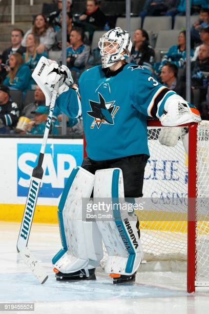 Martin Jones of the San Jose Sharks looks on during a NHL game against the Arizona Coyotes at SAP Center on February 13 2018 in San Jose California