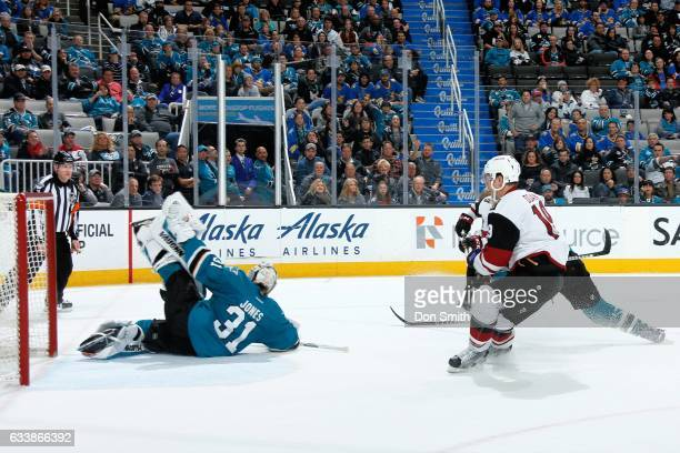 Martin Jones of the San Jose Sharks makes a big save in overtime play during a NHL game against the Arizona Coyotes at SAP Center at San Jose on...