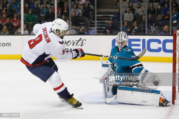 Martin Jones of the San Jose Sharks makes a glove save on a shot by Alex Ovechkin of the Washington Capitals at SAP Center on March 10 2018 in San...