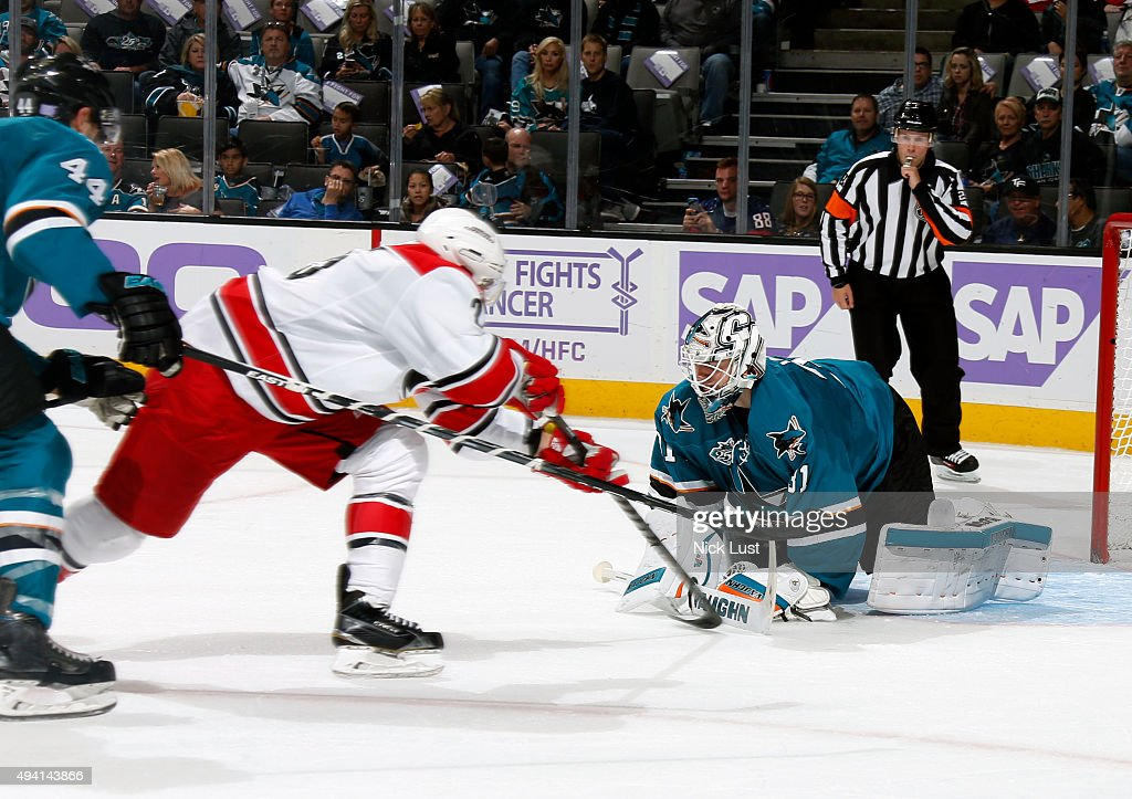 Martin Jones #31 of the San Jose Sharks makes a save against Brock McGinn #23 of the Carolina Hurricanes during a NHL game at the SAP Center at San Jose on October 24, 2015 in San Jose, California.