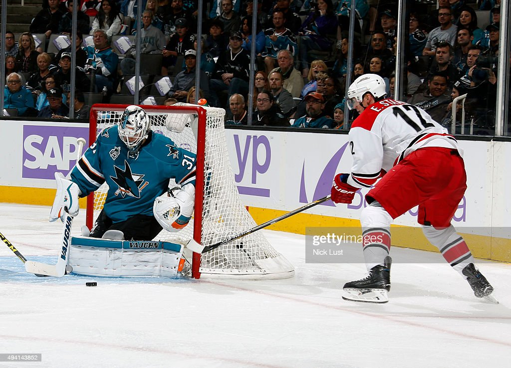 Martin Jones #31 of the San Jose Sharks makes a save against Eric Staal #12 of the Carolina Hurricanes during a NHL game at the SAP Center at San Jose on October 24, 2015 in San Jose, California.