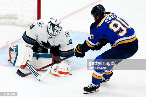 Martin Jones of the San Jose Sharks makes a save against Ryan O'Reilly of the St Louis Blues during the second period in Game Four of the Western...