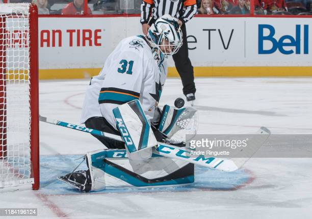 Martin Jones of the San Jose Sharks makes a save against the Ottawa Senators at Canadian Tire Centre on October 27 2019 in Ottawa Ontario Canada