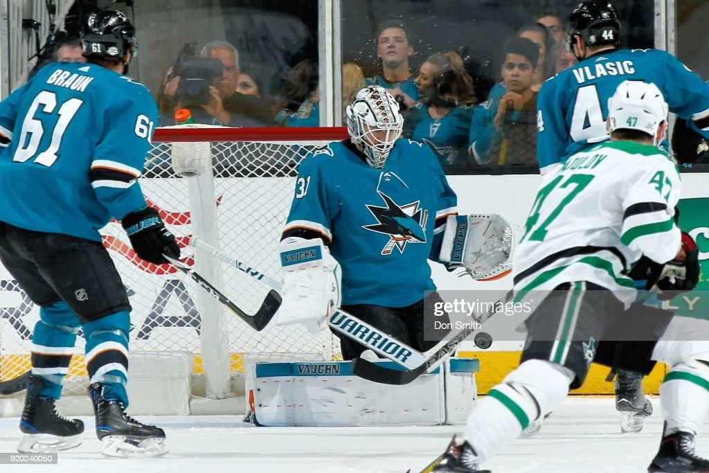 Martin Jones #31 of the San Jose Sharks makes a save during a NHL game against the Dallas Stars at SAP Center on February 18, 2018 in San Jose, California.
