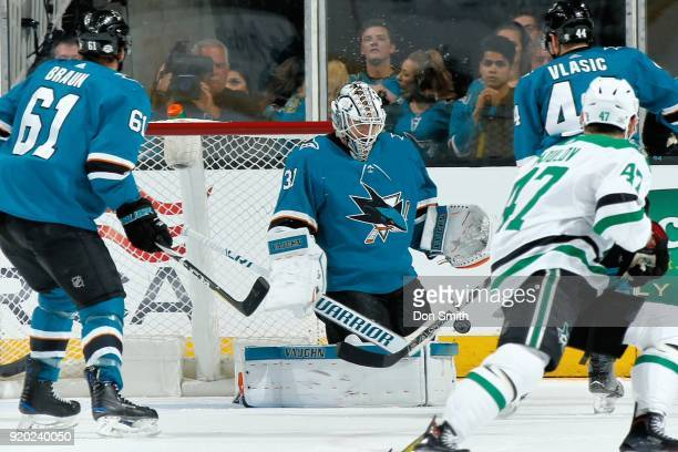 Martin Jones of the San Jose Sharks makes a save during a NHL game against the Dallas Stars at SAP Center on February 18 2018 in San Jose California