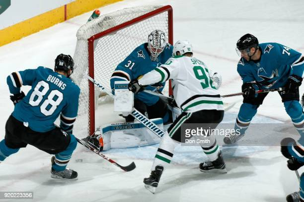 Martin Jones of the San Jose Sharks protects the net as Brent Burns and Dylan DeMelo of the San Jose Sharks defend Jason Spezza of the Dallas Stars...
