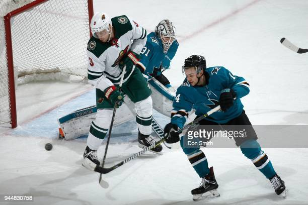 Martin Jones of the San Jose Sharks protects the net as Charlie Coyle of the Minnesota Wild and Dylan Gambrell of the San Jose Sharks battle for the...