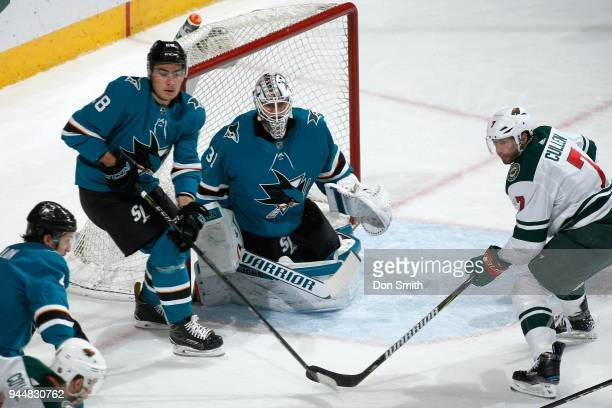 Martin Jones of the San Jose Sharks protects the net as Timo Meier of the San Jose Sharks and Matt Cullen of the Minnesota Wild watch the puck at SAP...