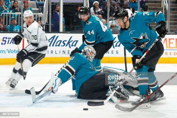 Martin Jones of the San Jose Sharks scrambles to protect the net as Dylan DeMelo and MarcEdouard Vlasic of the San Jose Sharks defend during a NHL...