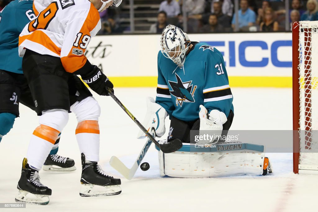 Martin Jones #31 of the San Jose Sharks stops a shot taken by Nolan Patrick #19 of the Philadelphia Flyers at SAP Center on October 4, 2017 in San Jose, California.