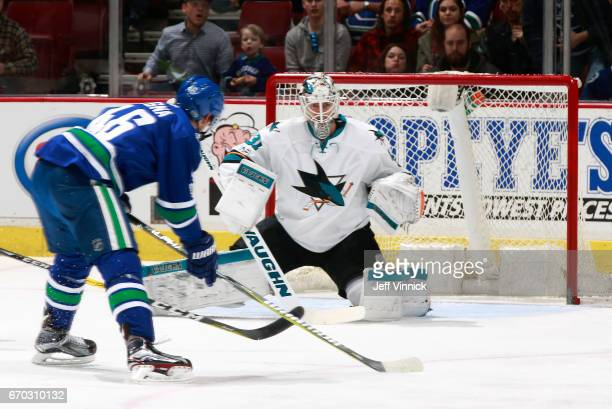 Martin Jones of the San Jose Sharks watches a Jayson Megna of the Vancouver Canucks lines up a shot during their NHL game at Rogers Arena April 2...