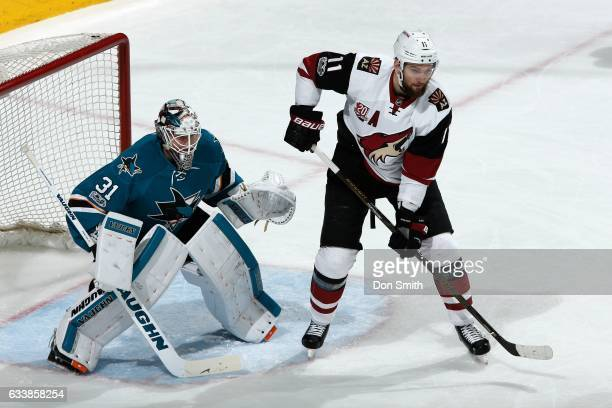 Martin Jones the San Jose Sharks defends against Martin Hanzal of the Arizona Coyotes at SAP Center at San Jose on February 4 2017 in San Jose...