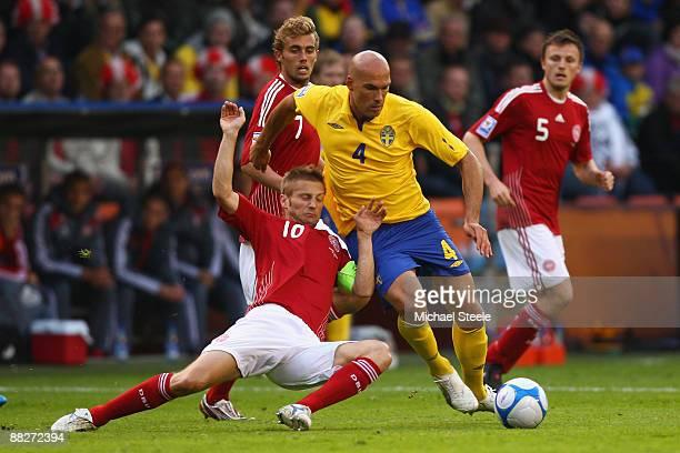 Martin Jorgensen of Denmark challenges Daniel Majstorovic of Sweden during the FIFA2010 World Cup Qualifying Group 1 match between Sweden and Denmark...