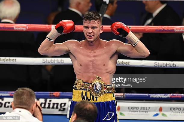 Martin Joseph Ward of Great Britain celebrates defeating Andy Townend of Great Britain for the vacant Super Featherweight title at The O2 Arena on...