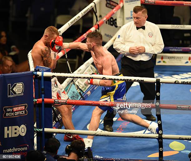 Martin Joseph Ward of Great Britain forces Andy Townend of Great Britain into the corner during the vacant Super Featherweight title fight at The O2...