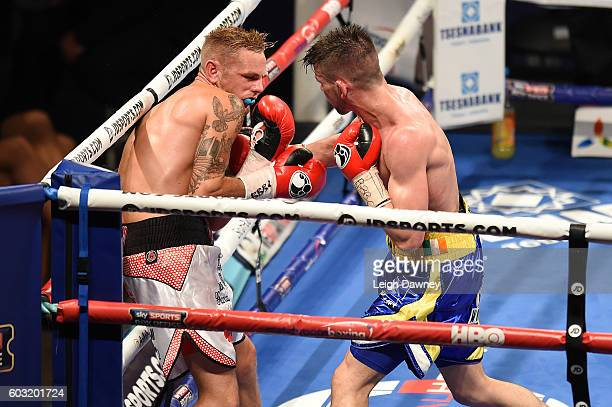 Martin Joseph Ward of Great Britain forces Andy Townend of Great Britain against the ropes during the vacant Super Featherweight title fight at The...