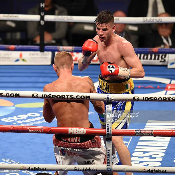 Martin Joseph Ward of Great Britain in action against Andy Townend of Great Britain during the vacant Super Featherweight title fight at The O2 Arena...