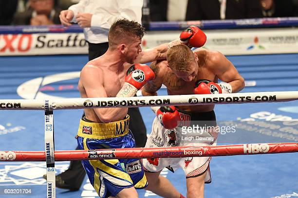 Martin Joseph Ward of Great Britain in action with Andy Townend of Great Britain during the vacant Super Featherweight title fight at The O2 Arena on...