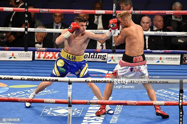 Martin Joseph Ward of Great Britain throws a left hand punch on Andy Townend of Great Britain during the vacant Super Featherweight title fight at...