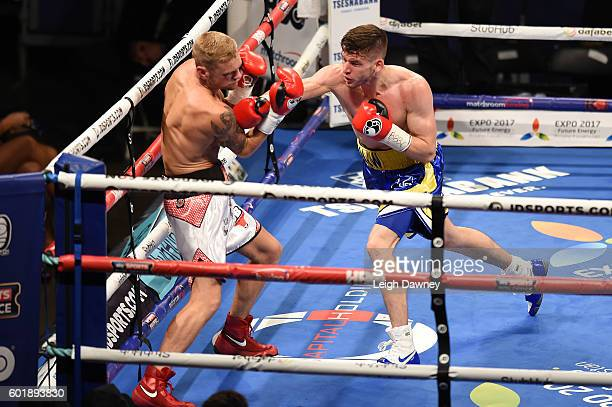 Martin Joseph Ward of Great Britain throws a right hand punch on Andy Townend of Great Britain during the vacant Super Featherweight title fight at...