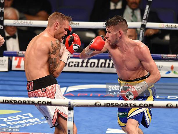 Martin Joseph Ward of Great Britain trades punches with Andy Townend of Great Britain during vacant Super Featherweight title fight at The O2 Arena...