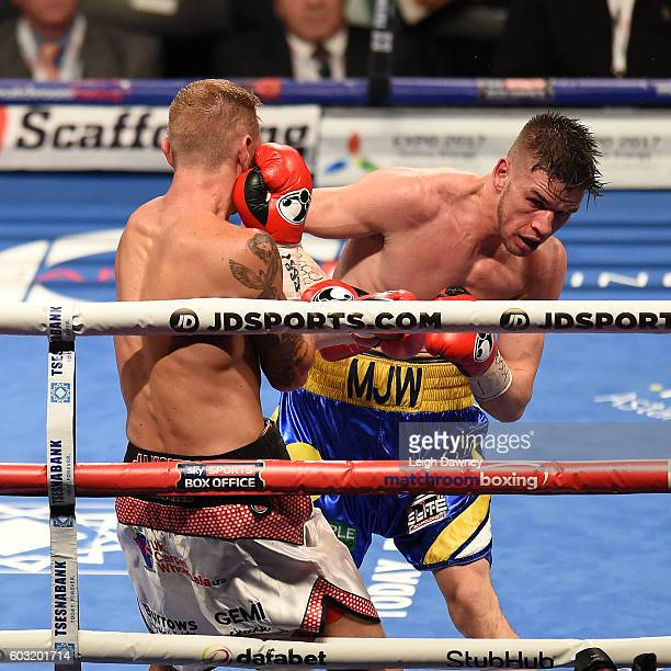 Martin Joseph Ward of Great Britain trades punches with Andy Townend of Great Britain during the vacant Super Featherweight title fight at The O2...