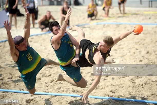 Martin Kaeck of Sweden shoots at goal during the Men's Preliminary Group A Beach Handball match between Australia and Sweden at Al-Gharrafa Sports...