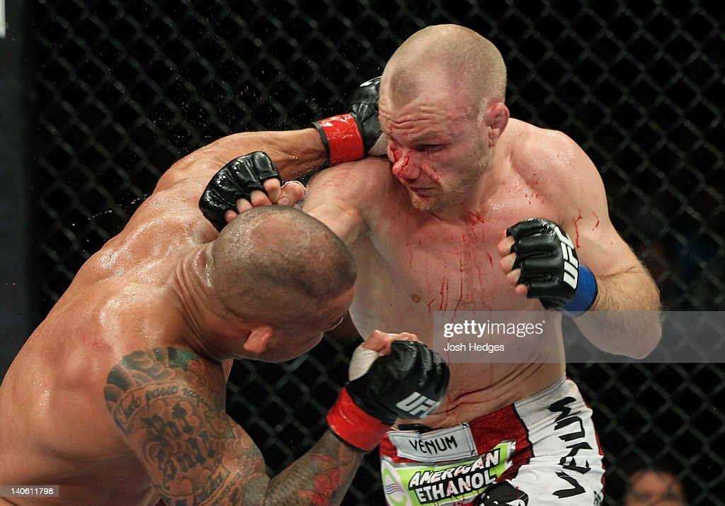 Martin Kampmann punches Thiago Alves in a welterweight bout during ...