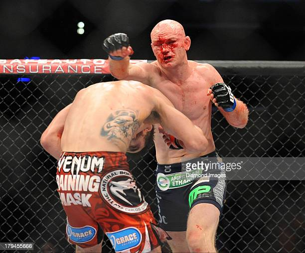 Martin Kampmann throws a punch at Carlos Condit during a welterweight bout during UFC Fight Night 27 Condit v Kampmann 2 at Bankers Life Field House...