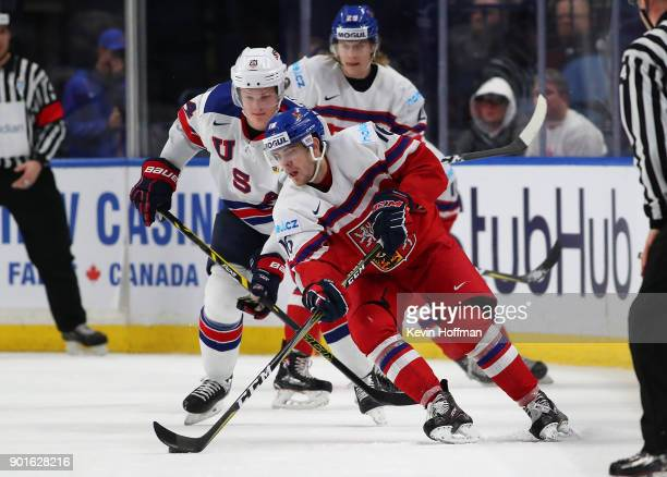 Martin Kaut of Czech Republic with the puck as Trent Frederic of United States defends in the first period during the Bronze Medal Game of the IIHF...