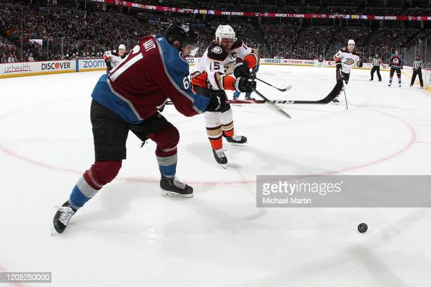 Martin Kaut of the Colorado Avalanche fights for the puck against Ryan Getzlaf of the Anaheim Ducks at Pepsi Center on March 04 2020 in Denver...
