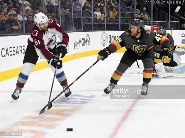 Martin Kaut of the Colorado Avalanche passes against Jake Bischoff of the Vegas Golden Knights in the third period of their preseason game at TMobile...