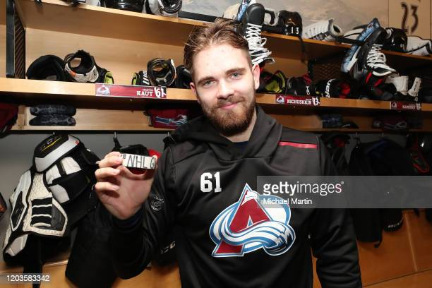 Martin Kaut of the Colorado Avalanche poses with his first goal puck after the victory against the Buffalo Sabres at Pepsi Center on February 26 2020...