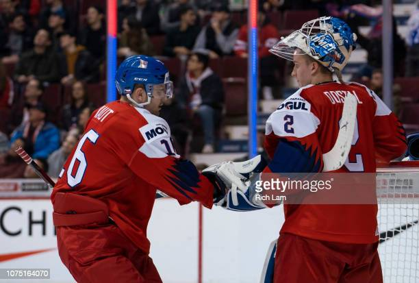 Martin Kaut of the Czech Republic celebrates with goalie Lukas Dostal after scoring against Switzerland in Group A hockey action of the 2019 IIHF...