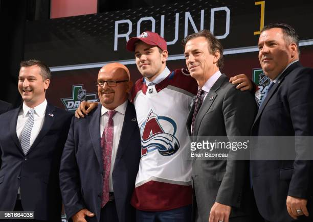 Martin Kaut poses with team personel onstage after being selected sixteenth overall by the Colorado Avalanche during the first round of the 2018 NHL...