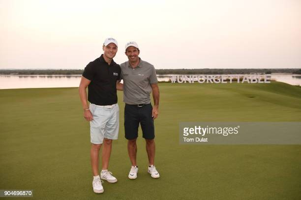 Martin Kaymer and Luis Figo pose at the 18th green during The Abu Dhabi Invitational at Yas Links Golf Course on January 13 2018 in Abu Dhabi United...