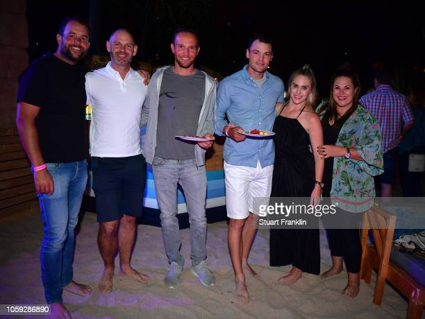 Martin Kaymer and Maximilian Kiefer of Germany and friends at the beach party after the first round of the Nedbank Golf Challenge at Gary Player CC...