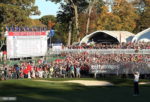 Martin Kaymer of Europe celebrates after holing the decisive putt on the 18th green during the Singles Matches for The 39th Ryder Cup at Medinah...