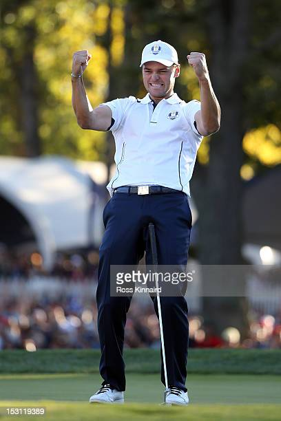 Martin Kaymer of Europe celebrates after making the winning putt on the 18th green to win The 39th Ryder Cup at Medinah Country Club on September 30...