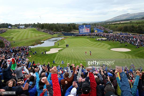Martin Kaymer of Europe chips in on the 16th hole to win his match during the Singles Matches of the 2014 Ryder Cup on the PGA Centenary course at...