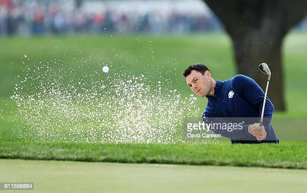 Martin Kaymer of Europe hits out of a bunker on the ninth hole during morning foursome matches of the 2016 Ryder Cup at Hazeltine National Golf Club...