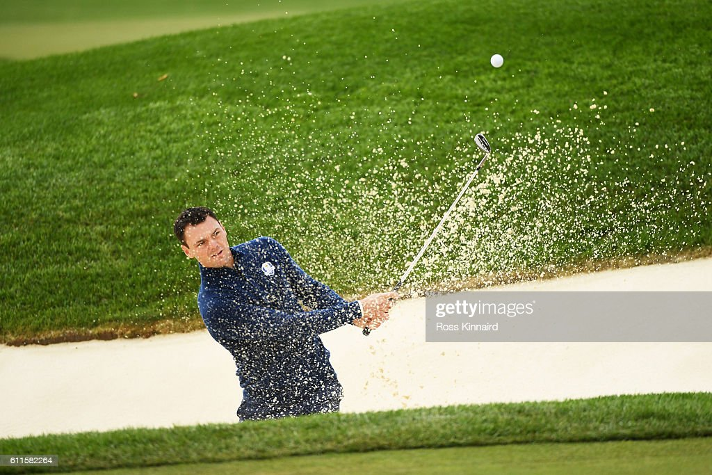 Martin Kaymer of Europe hits out of a bunker on the ninth hole during morning foursome matches of the 2016 Ryder Cup at Hazeltine National Golf Club on September 30, 2016 in Chaska, Minnesota.