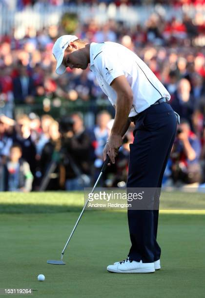 Martin Kaymer of Europe hits the decisive putt on the 18th green during the Singles Matches for The 39th Ryder Cup at Medinah Country Club on...