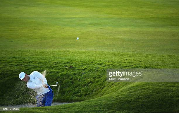Martin Kaymer of Europe plays out of a bunker on the 3rd hole during the Morning Fourballs of the 2014 Ryder Cup on the PGA Centenary course at the...