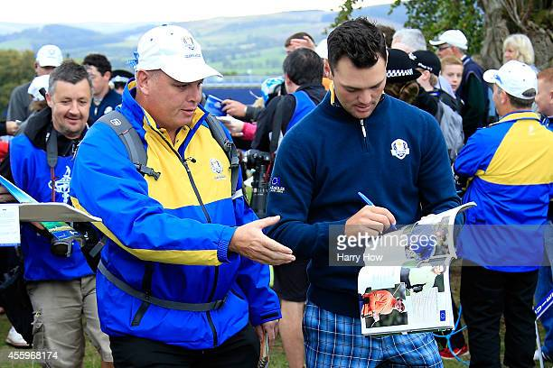 Martin Kaymer of Europe signs autographs during practice ahead of the 2014 Ryder Cup on the PGA Centenary course at the Gleneagles Hotel on September...