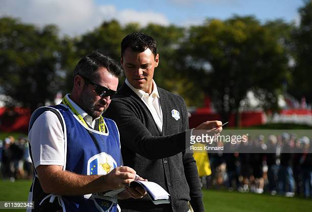 Martin Kaymer of Europe speaks to caddie Craig Connelly during practice prior to the 2016 Ryder Cup at Hazeltine National Golf Club on September 29...
