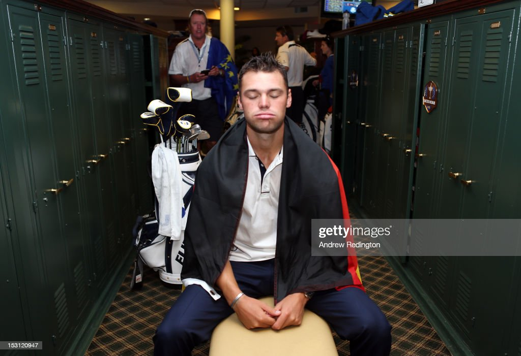 Martin Kaymer of Europe takes a moment in the locker room after making the winning putt for Europe to defeat Team United States in The 39th Ryder Cup at Medinah Country Club on September 30, 2012 in Medinah, Illinois.