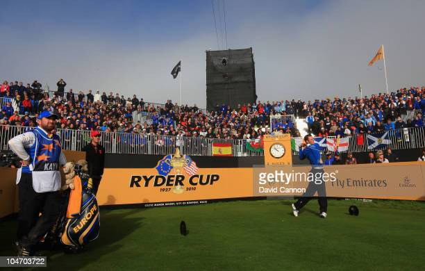 Martin Kaymer of Europe watches his tee shot on the first hole in the singles matches during the 2010 Ryder Cup at the Celtic Manor Resort on October...