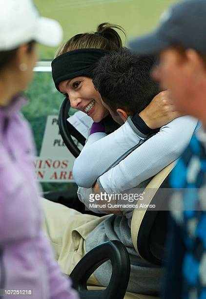 Martin Kaymer of Germany accompanies his girlfriend Allison Micheletti of the United States as she takes part in the Ladies European Tour...
