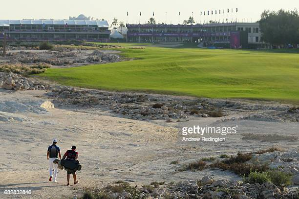 Martin Kaymer of Germany and his caddie Craig Connelly walk up the 18th fairway during the second round of the Commercial Bank Qatar Masters at the...